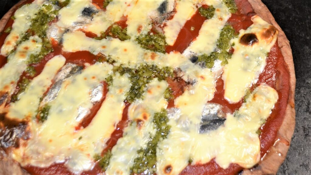 Nadezda Mikusova. Baked chocolate pizza with marinated sardines